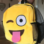 yellow smile wink wearing the backpack